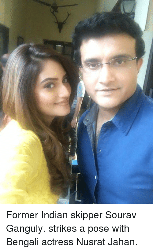 Bengali: 厂 Former Indian skipper Sourav Ganguly. strikes a pose with Bengali actress Nusrat Jahan.