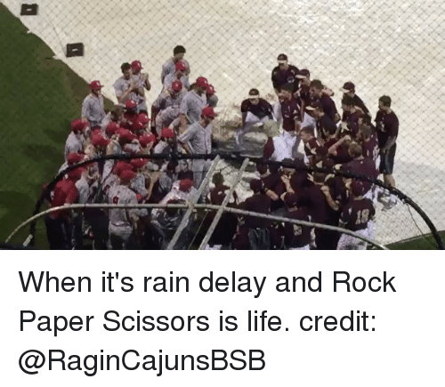 rain delay: 弋 When it's rain delay and Rock Paper Scissors is life. credit: @RaginCajunsBSB