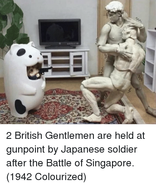 Colourized: 2 British Gentlemen are held at gunpoint by Japanese soldier after the Battle of Singapore. (1942 Colourized)