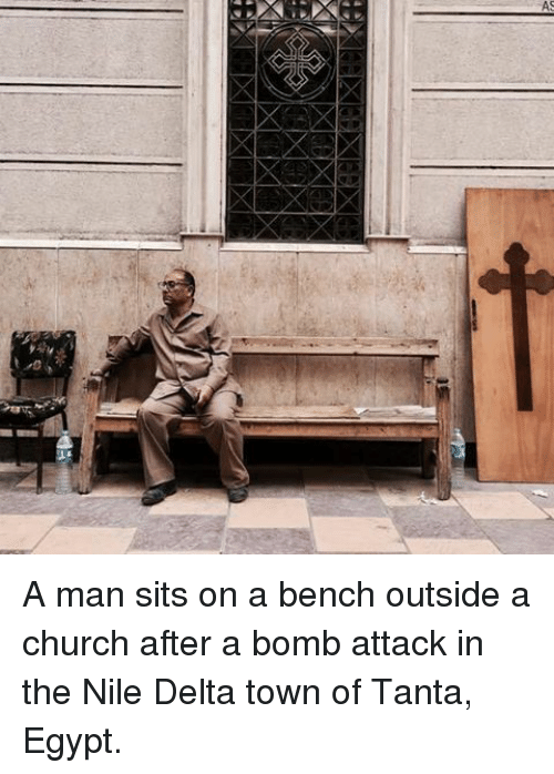 О: A A man sits on a bench outside a church after a bomb attack in the Nile Delta town of Tanta, Egypt.