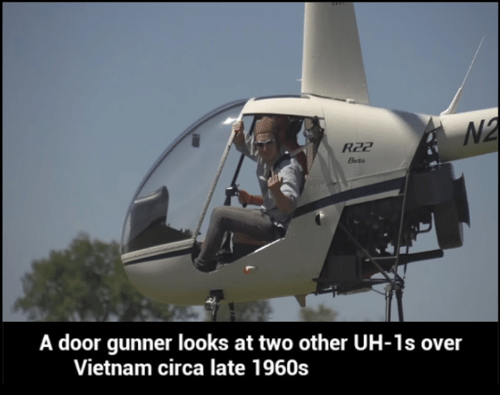 Dank Memes: A door gunner looks at two other UH-1s over  Vietnam circa late 1960s