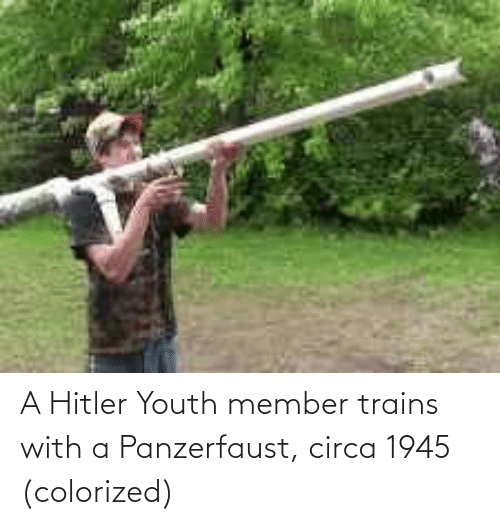 panzerfaust: A Hitler Youth member trains with a Panzerfaust, circa 1945 (colorized)