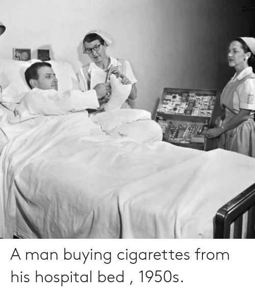 Hospital Bed: A man buying cigarettes from his hospital bed , 1950s.