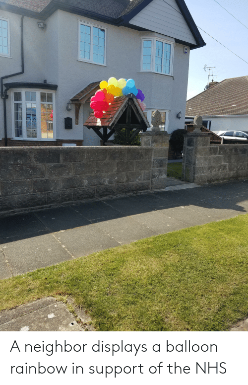 balloon: A neighbor displays a balloon rainbow in support of the NHS