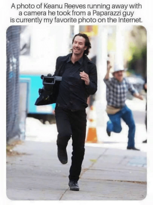 running away: A photo of Keanu Reeves running away with  a camera he took from a Paparazzi guy  is currently my favorite photo on the Internet.