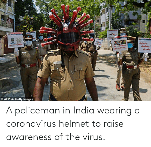 helmet: A policeman in India wearing a coronavirus helmet to raise awareness of the virus.
