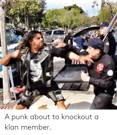 Member: A punk about to knockout a klan member.