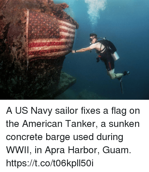 us navy: A US Navy sailor fixes a flag on the American Tanker, a sunken concrete barge used during WWII, in Apra Harbor, Guam. https://t.co/t06kpll50i
