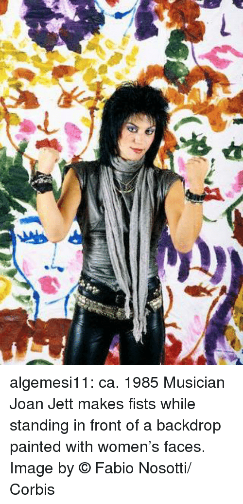 Fabio: algemesi11:    ca. 1985 Musician Joan Jett makes fists while standing in front of a backdrop painted with women's faces. Image by © Fabio Nosotti/ Corbis