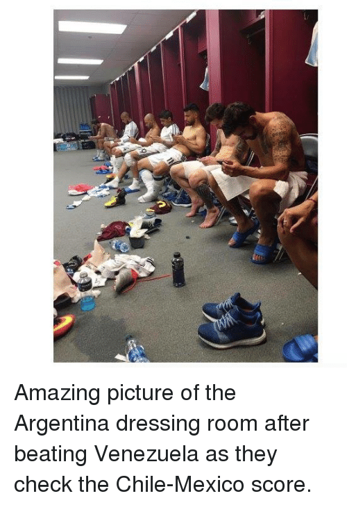 Soccer, Amaz, and Argentina: Amazing picture of the Argentina dressing room after beating Venezuela as they check the Chile-Mexico score.
