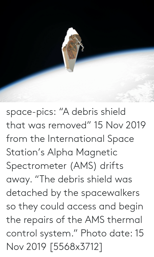 "International: AMS-02 space-pics:  ""A debris shield that was removed"" 15 Nov 2019 from the International Space Station's Alpha Magnetic Spectrometer (AMS) drifts away. ""The debris shield was detached by the spacewalkers so they could access and begin the repairs of the AMS thermal control system."" Photo date: 15 Nov 2019 [5568x3712]"