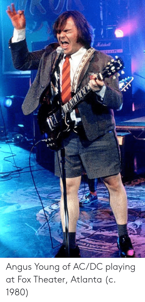 angus: Angus Young of AC/DC playing at Fox Theater, Atlanta (c. 1980)