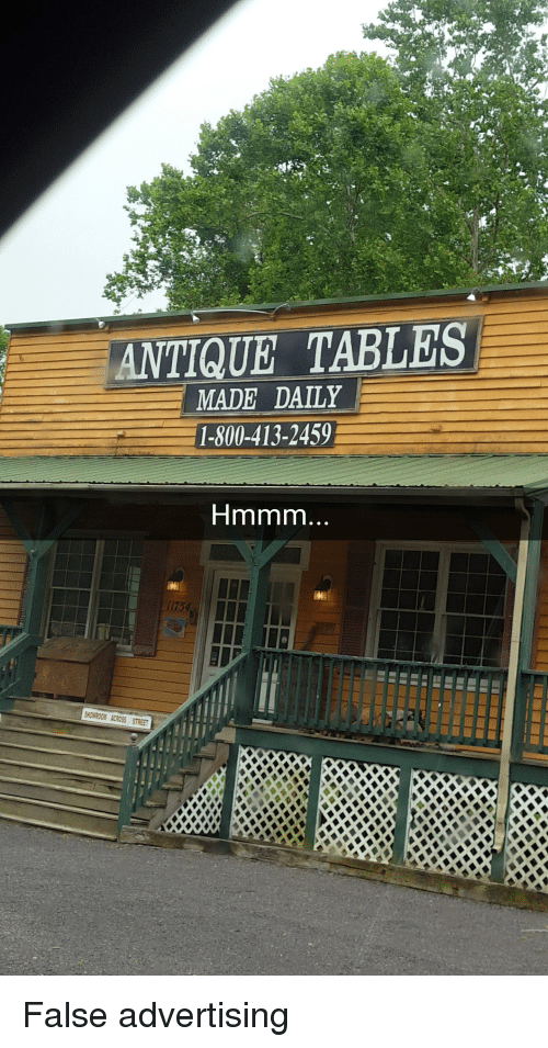 False Advertising: ANTIQUE TABLES  MADE DAILY  1-800-413-2459  Hmmm  OMROON ACROSS STREET False advertising
