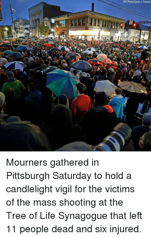 vigil: (AP Photo/Gene J. Puskar)  Forbes Ave Mourners gathered in Pittsburgh Saturday to hold a candlelight vigil for the victims of the mass shooting at the Tree of Life Synagogue that left 11 people dead and six injured.