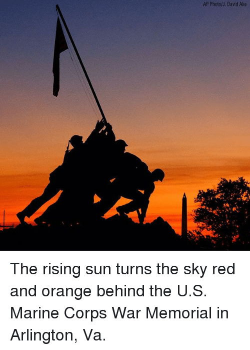Memes, Orange, and 🤖: AP Photo/J. David Ake  ue The rising sun turns the sky red and orange behind the U.S. Marine Corps War Memorial in Arlington, Va.