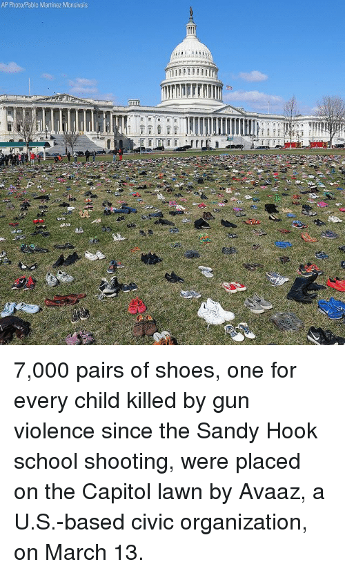 sandy hook: AP Photo/Pablo Martinez Monsivais  rrn 7,000 pairs of shoes, one for every child killed by gun violence since the Sandy Hook school shooting, were placed on the Capitol lawn by Avaaz, a U.S.-based civic organization, on March 13.