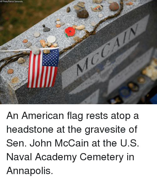 American Flag: AP Photo/Patrick Semansky An American flag rests atop a headstone at the gravesite of Sen. John McCain at the U.S. Naval Academy Cemetery in Annapolis.