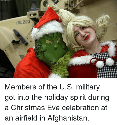 Gül: AP Photo/Rahmat Gul)  IOL203 Members of the U.S. military got into the holiday spirit during a Christmas Eve celebration at an airfield in Afghanistan.