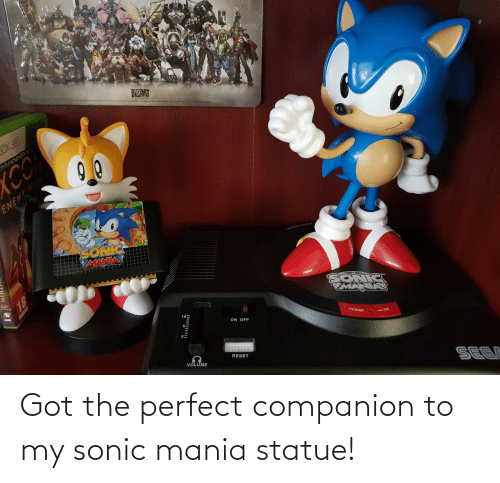 Sonic Mania: BILZARD  RTERYRINNE  Es Eirmen  OX 380  OMMANDER E  YCO  ENEMY WITH  SONIC  FIRAXIS  RK  SONICS  MANIAS  PAL  10  ON OFF  POWER  -ON  RESET  VOLUME  SEGN  81 Got the perfect companion to my sonic mania statue!