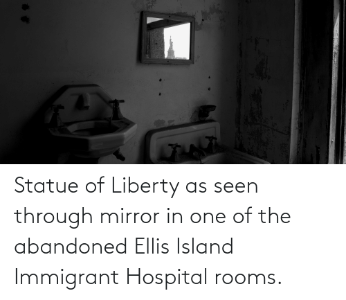ellis island: Brg Phaes Statue of Liberty as seen through mirror in one of the abandoned Ellis Island Immigrant Hospital rooms.