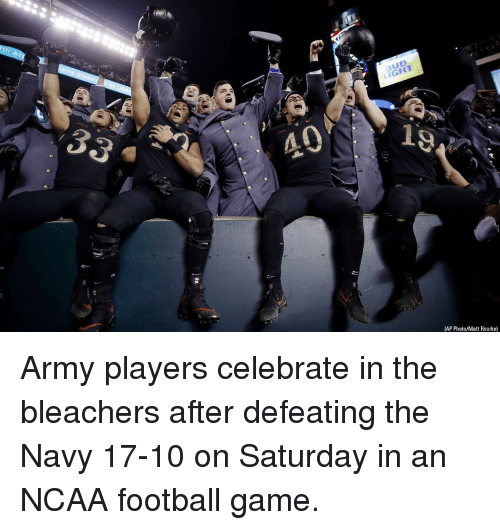 Bleachers: BUD  LIGHT  40  (AP Photo/Matt Rourke) Army players celebrate in the bleachers after defeating the Navy 17-10 on Saturday in an NCAA football game.
