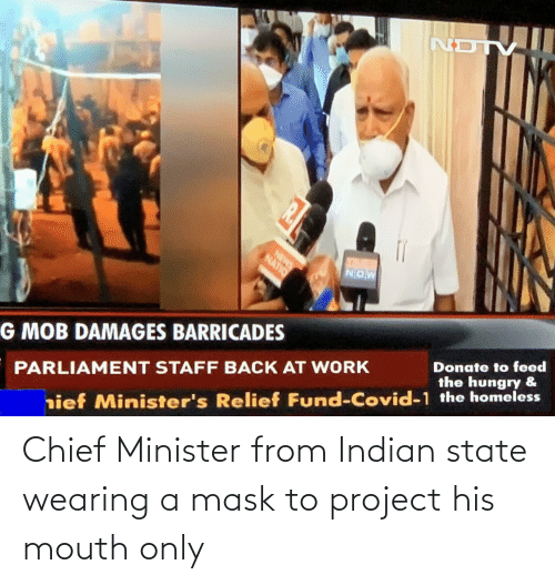 Indian: Chief Minister from Indian state wearing a mask to project his mouth only