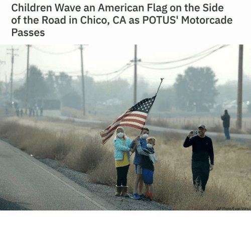 American Flag: Children Wave an American Flag on the Side  of the Road in Chico, CA as POTUS' Motorcade  Passes