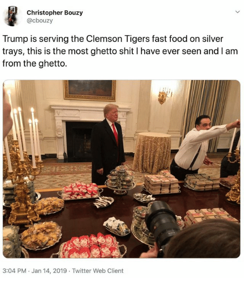 clemson tigers: Christopher Bouzy  @cbouzy  Trump is serving the Clemson Tigers fast food on silver  trays, this is the most ghetto shit I have ever seen and I am  from the ghetto.  3:04 PM. Jan 14, 2019 Twitter Web Client