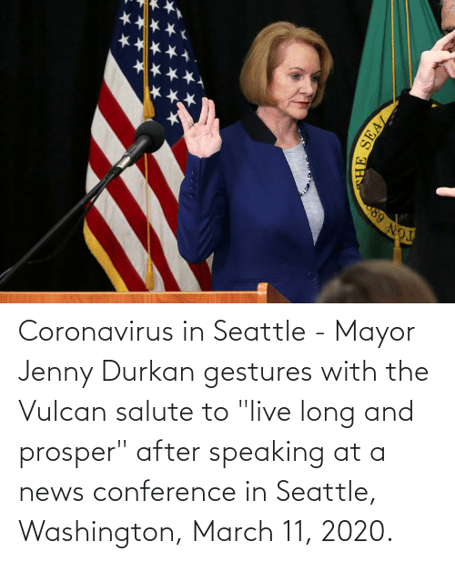 """Gestures: Coronavirus in Seattle - Mayor Jenny Durkan gestures with the Vulcan salute to """"live long and prosper"""" after speaking at a news conference in Seattle, Washington, March 11, 2020."""
