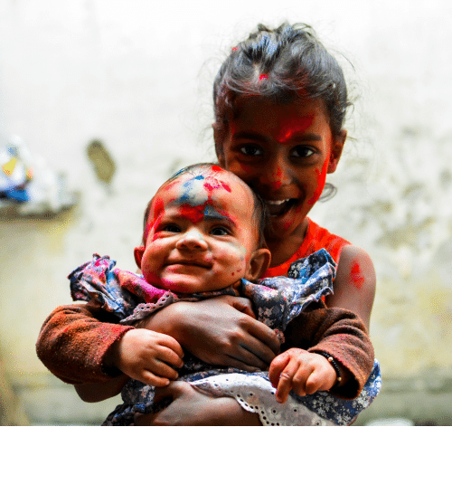 holi: cute baby with Holi colors