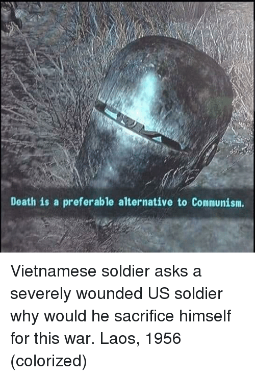 laos: Death is a preferable alternative to Communism. Vietnamese soldier asks a severely wounded US soldier why would he sacrifice himself for this war. Laos, 1956 (colorized)