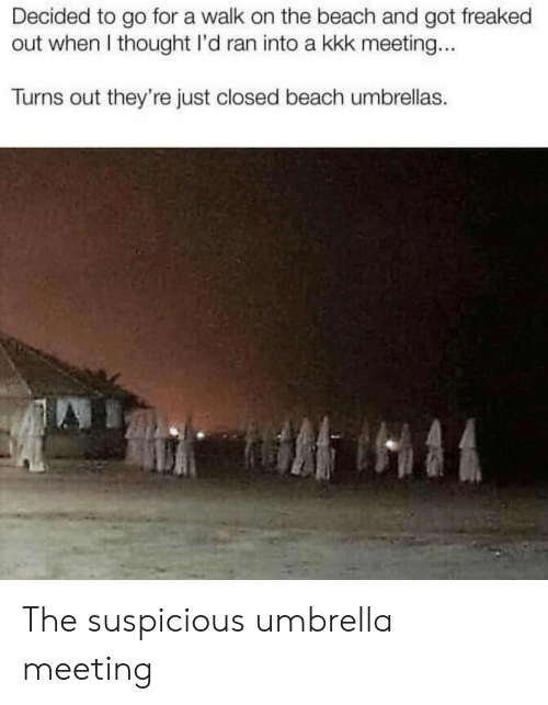 Freaked Out: Decided to go for a walk on the beach and got freaked  out when I thought I'd ran into a kkk meeting...  Turns out they're just closed beach umbrellas. The suspicious umbrella meeting