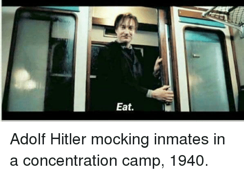concentration camp: Eat. Adolf Hitler mocking inmates in a concentration camp, 1940.