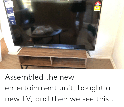 New Tv: ENERGY  RATING  HDR  Sim Assembled the new entertainment unit, bought a new TV, and then we see this...