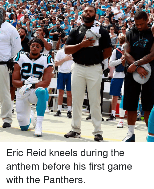 Game, Panthers, and First: Eric Reid kneels during the anthem before his first game with the Panthers.