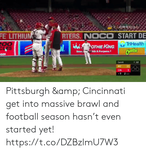 Cincinnati: FE LITHIUNM  RTERS. NOCO START DE  TriHealth  00  CLES  OTHIE KING  Cheelas  Smo  lith A Purpose.  -om  P: 12  Garrett  11  PIT  3  CIN  9  2 Outs Pittsburgh & Cincinnati get into massive brawl and football season hasn't even started yet! https://t.co/DZBzlmU7W3