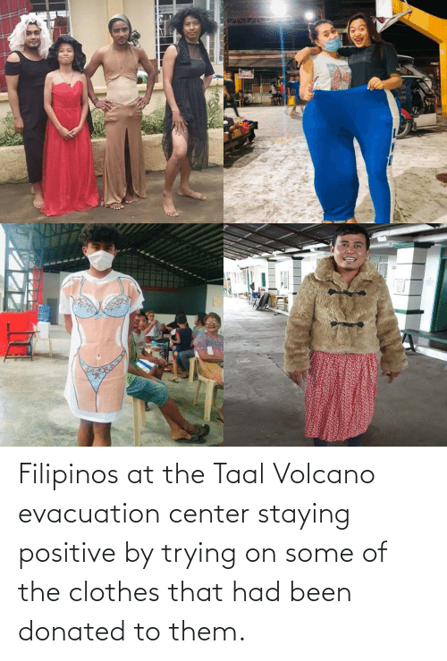 Volcano: Filipinos at the Taal Volcano evacuation center staying positive by trying on some of the clothes that had been donated to them.