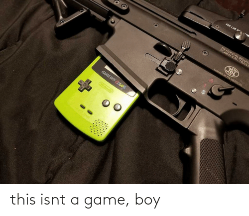 game boy color: FOR LAW E  FN HERSTAL BELGIU  SCAR-H CAL  . 7.62x5I  LICENSED BY FN HERSTAL  GAME BOY COLOR  Ointonc this isnt a game, boy