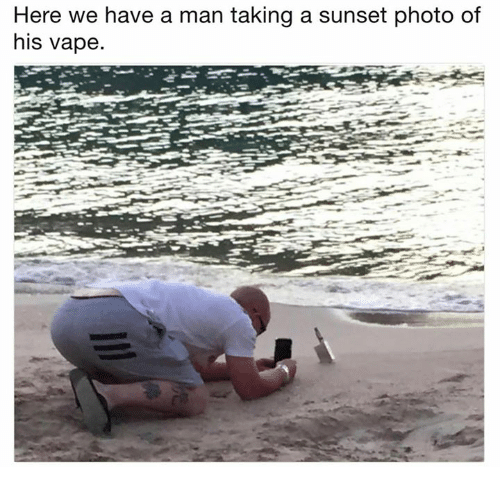 Vape, Sunset, and Photo: Here we have a man taking a sunset photo of  his vape