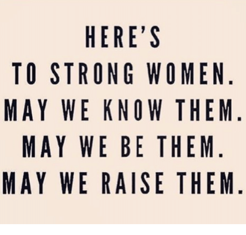 Twies: HERE'S  TO STRONG WOMEN  MAY WE KNOW THEM  MAY WE BE THEM  MAY WE RAISE THEM  NM  EEME  HE  TH  HT  SWWTE  OES  GNBA  ER  HREWE  TWY  YW  YA  0AMA  TM