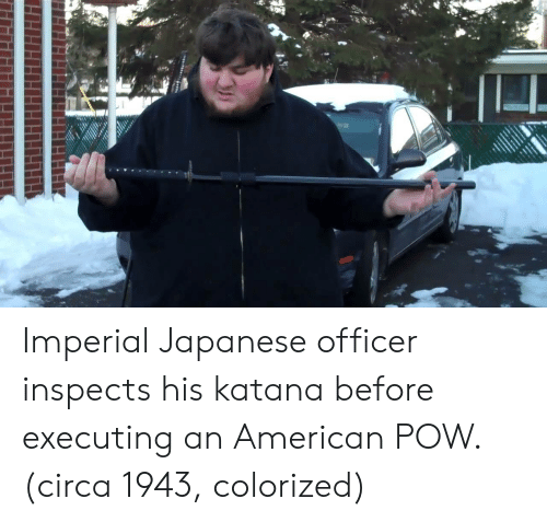 katana: Imperial Japanese officer inspects his katana before executing an American POW. (circa 1943, colorized)