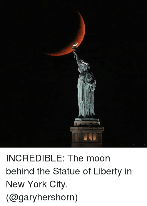 Statue of Liberty: INCREDIBLE: The moon behind the Statue of Liberty in New York City. (@garyhershorn)