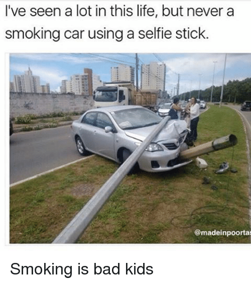 Memes, 🤖, and Sticks: I've seen a lot in this life, but never a  smoking car using a selfie stick.  @madeinpoortaa Smoking is bad kids