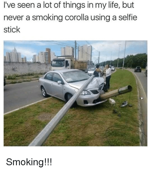 Life, Selfie, and Smoking: I've seen a lot of things in my life, but  never a smoking corolla using a selfie  stick <p>Smoking!!!</p>