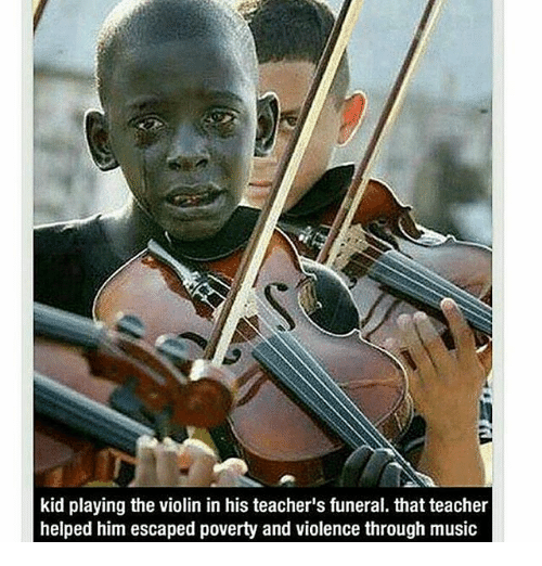 violins: kid playing the violin in his teacher's funeral. that teacher  helped him escaped poverty and violence through music