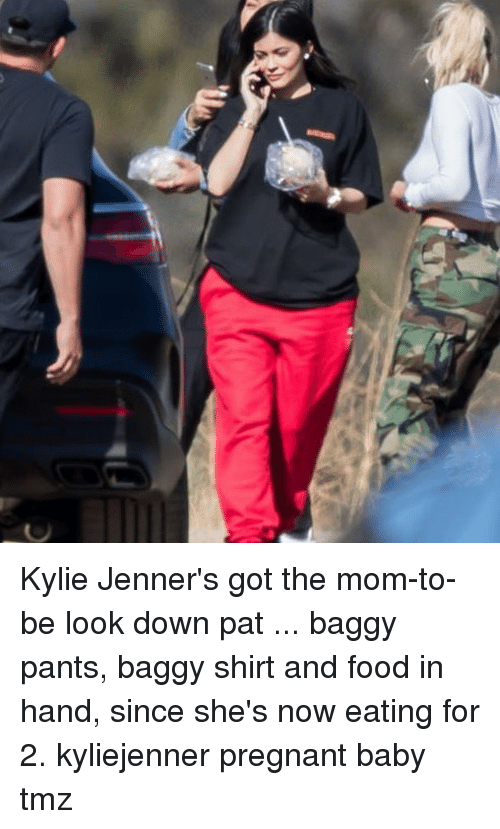 Food, Memes, and Pregnant: Kylie Jenner's got the mom-to-be look down pat ... baggy pants, baggy shirt and food in hand, since she's now eating for 2. kyliejenner pregnant baby tmz