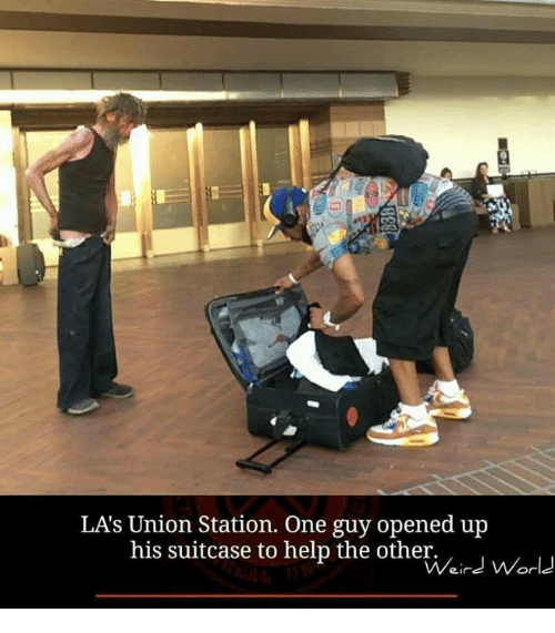 Memes, 🤖, and The Others: LAs Union Station. One guy opened up  his suitcase to help the other.  Weird World
