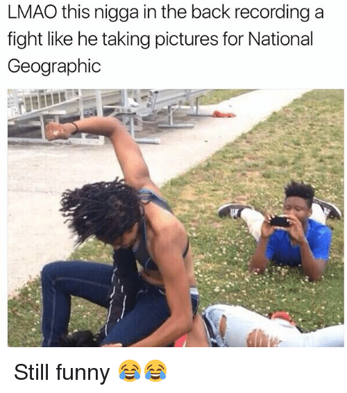 Funny, Lmao, and National Geographic: LMAO this nigga in the back recording a  fight like he taking pictures for National  Geographic Still funny 😂😂