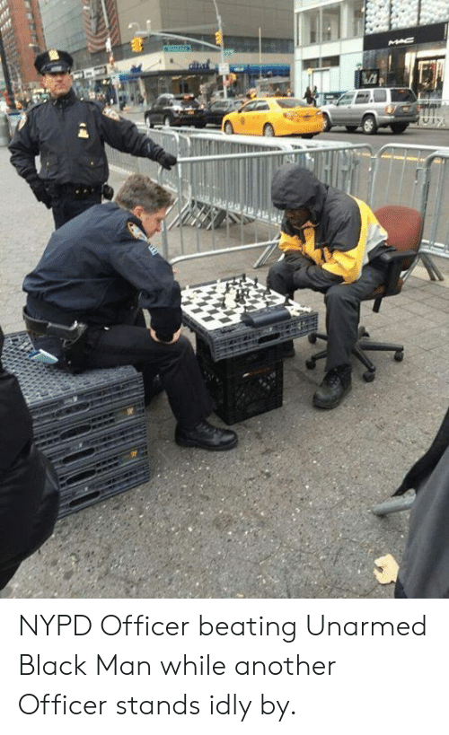 Black Man: MAC NYPD Officer beating Unarmed Black Man while another Officer stands idly by.