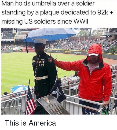 America, Memes, and Soldiers: Man holds umbrella over a soldier  standing by a plaque dedicated to 92k +  missing US soldiers since WWI This is America